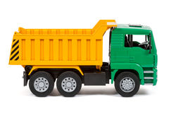 Dump truck. The toy dump truck on a white background Royalty Free Stock Image