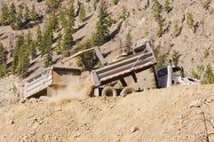 Dump truck and trailer unloading dirt Stock Image