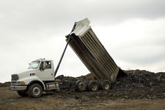 Dump Truck unloading stock photography
