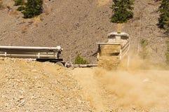 Dump truck unloading dirt stock photography