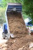 Dump Truck Unloading Soil Royalty Free Stock Images