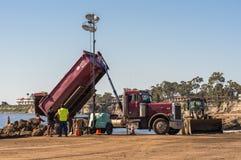 Dump truck unloads dirt on Goleta Beach, California. Santa Barbara, United States - Febriary 16, 2018: Dump truck unloads off-flooding dirt from Montecity fire royalty free stock photos