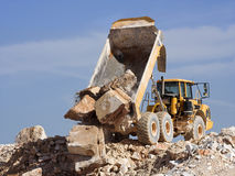 Dump truck at work Stock Images
