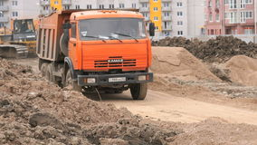 Dump truck working on a construction site. MOSCOW, RUSSIA - JULY 07, 2017: Construction site. Dump truck working on a construction site carry clay from one stock video