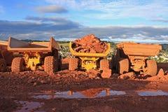 Dump Trucks. On a construction site Stock Photos