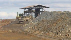 Dump trucks. Unloading mineral in open pit mine stock video
