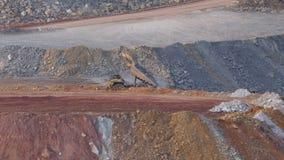 Dump trucks. Unloading mineral in open pit mine stock video footage