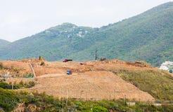 Dump Trucks and Heavy Equipment on Hilltop Construction Stock Photos