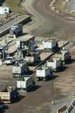 Dump trucks lined up at a rock quarry Royalty Free Stock Photos