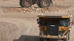 Dump trucks. In open pit mine stock footage