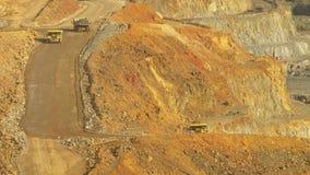 Dump trucks. In open pit mine road stock video footage