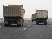 Dump trucks on the road. royalty free stock image