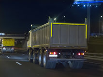 Dump trucks transport freight on the night. Highway Stock Images