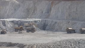 Dump trucks. Waiting for clearance in open pit mine stock video footage