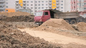 Dump trucks working on a construction site stock footage