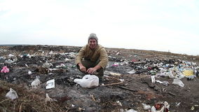 Dump unemployed homeless dirty looking food waste. In man a landfill social  video stock video