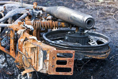 Dumped burnt-out motor bike Royalty Free Stock Photos
