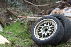 Free Dumped Car Tyres. Fly-tipping Old Tyre Waste And Rubber Recycling Stock Image - 169680281