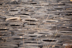 Dumped old car tires Royalty Free Stock Image