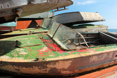 Dumped old motorboats. On beach Stock Photo