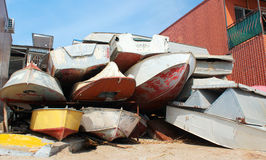 Dumped old motorboats. On the beach Royalty Free Stock Images