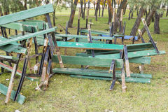 Dumped in a pile of broken wooden green benches . Reconstruction and repair in city Park stock image