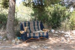 Dumped sofa Stock Photo
