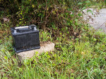 Dumped used car battery. Rubbish disposal, environment problem. Royalty Free Stock Photos