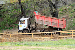 Dumper. Road construction machinery. Zhukovskiy, Russia - May 02, 2017: Editorial use only. Dumper on new road. Road construction machinery Royalty Free Stock Photos