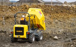 A dumper truck on a building site tipping soil Stock Photo