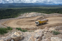 Dumper truck carrying rocks in a quarry Stock Photos