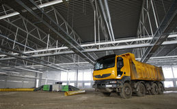 Dumper truck on construction site. Dumper truck in an unfinished building Royalty Free Stock Photos