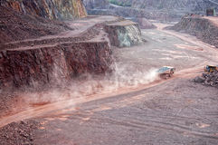 Dumper truck driving along in quarry mine pit Royalty Free Stock Photos