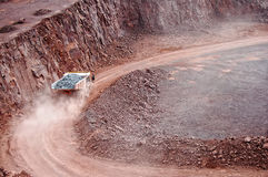 Dumper truck driving along in quarry mine pit Stock Images