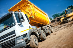 Dumper truck at industrial constrution site waiting for the earth Stock Photos