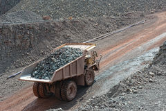 Dumper truck with loaded stones driving along in a quary. mining Royalty Free Stock Image