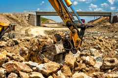 Dumper truck loading rocks and sand on construction site Stock Images