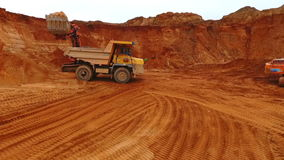 Dumper truck at sand mine. Drone view of mining truck working at sand quarry stock video footage