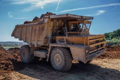 Dumper truck with soil. Rocks or clay Stock Images