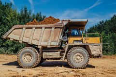 Dumper truck with soil. Rocks or clay Royalty Free Stock Image