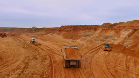 Dumper truck transporting sand in quarry. Aerial view of sand work stock footage
