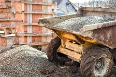 Dumper truck unloading construction gravel, sand and curshed stones Royalty Free Stock Photography