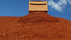 Dumper truck unloading ore for manufacturing plant.  stock footage