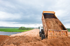 Dumper truck unloading soil Stock Photography