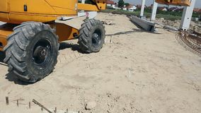 Zrenjanin, Vojvodina, Serbia - May 21, 2015: Dump truck is unloading soil. Dumper truck is unloading soil or sand at construction site stock video footage