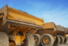 Dumper trucks. With copy space and blue sky Stock Photos