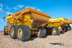 Dumper trucks on a beach Royalty Free Stock Photography