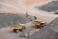 Dumper trucks parking in a surface mine. Stock Photos