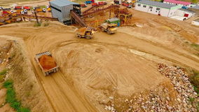 Dumper trucks with sand standing on territory industrial factory. Aerial view. Tipper trucks on industrial plant sky view. View from above cargo trucks on stock video