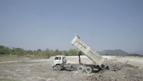 Dumpers truck leaving soil on the ground. Dumpers truck are leaving soil on the ground stock video